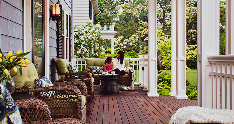 Mother and daughter spending time on backyard deck